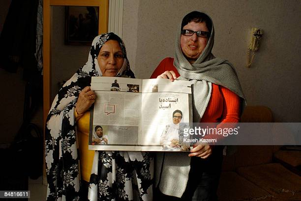 Ameneh Bahrami and her mother stand holding a magazine with her story published inside Ameneh Bahrami was blinded by Majid Movahedi in an acid attack...