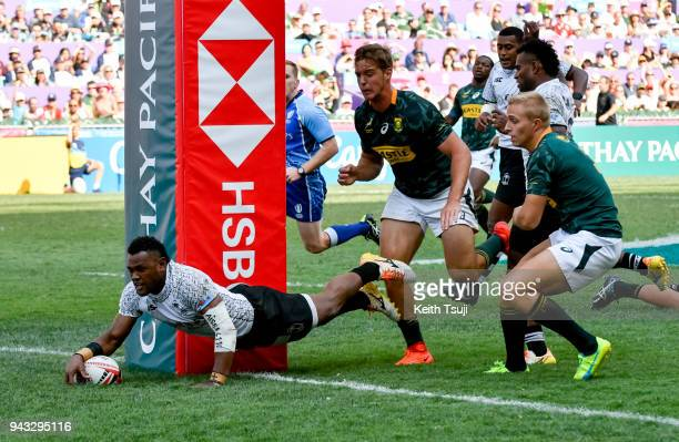 Amenoni Nasilasila of Fiji dives in to score a try in the Semi-final match against South Africa during the Hong Kong Sevens on April 8, 2018 in Hong...