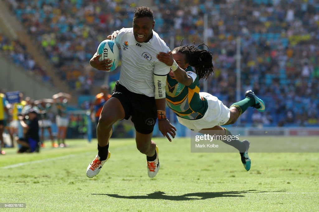 Amenoni Nasilasila of Fiji evades the tackle of Cecil Afrika of South Africa to score a try in extra time try to give Fiji vicitory during the men's Rugby Sevens semi final match between Fiji and South Africa on day 11 of the Gold Coast 2018 Commonwealth Games at Robina Stadium on April 15, 2018 on the Gold Coast, Australia.