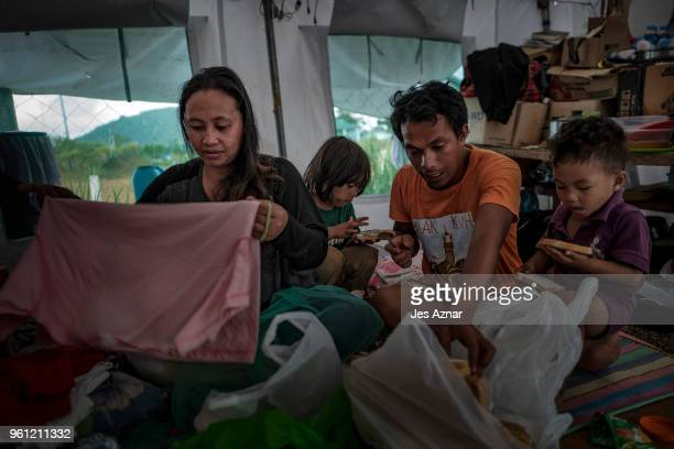 Amenoray Pundato and her family inside a shelter in Sarimanok tent city on May 15 2018 in Marawi Philippines Mrs Pundatoâs family was one of the...