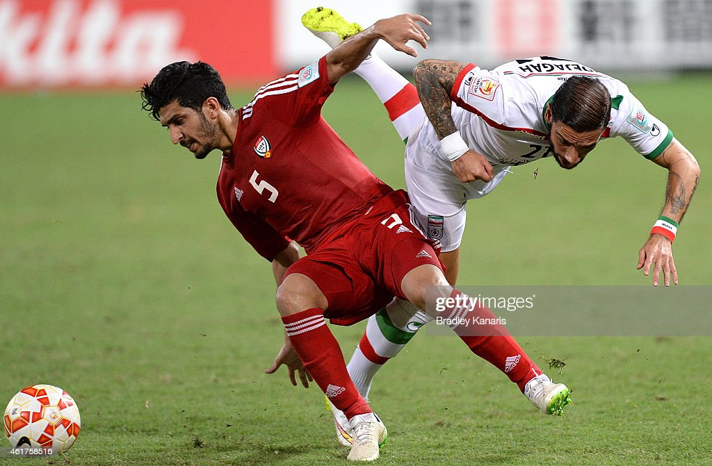 Amer Abdulrahman of the United Arab Emirates and Ashkan Dejagah of Iran challenge for the ball during the 2015 Asian Cup match between IR Iran and the UAE at Suncorp Stadium on January 19, 2015 in Brisbane, Australia.