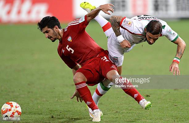 Amer Abdulrahman of the United Arab Emirates and Ashkan Dejagah of Iran challenge for the ball during the 2015 Asian Cup match between IR Iran and...