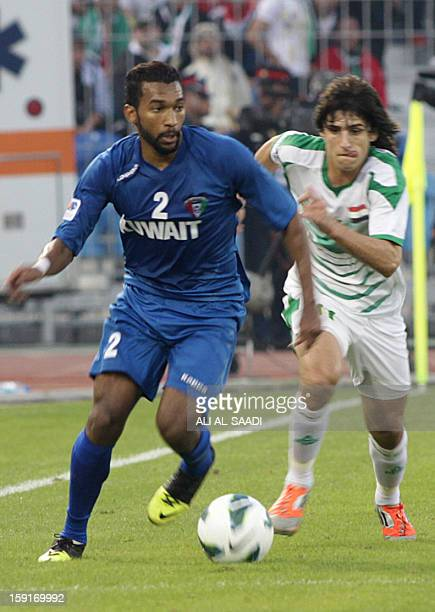 Amer alFadhel of Kuwait vies for the ball against Fahed alEbrahim of Iraq during their 21st Gulf Cup football match in Manama on January 9 2013 AFP...