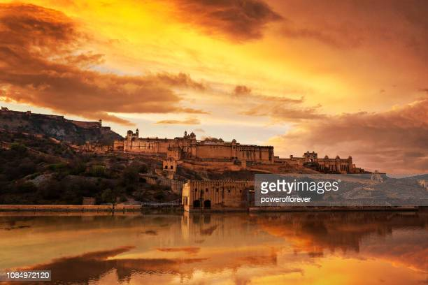 amer fort at sunset in jaipur, india - fortress stock pictures, royalty-free photos & images