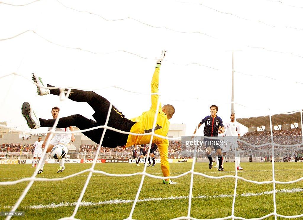Amer Sabbah of Jordan saves during the FIFA World Cup Asian qualifier match between Jordan and Japan at King Abdullah International Stadium on March 26, 2013 in Amman, Jordan.