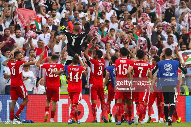 Amer Shafi of Jordan celebrate with his team mates their victory over Australia at the end of the AFC Asian Cup Group B match between Australia and...