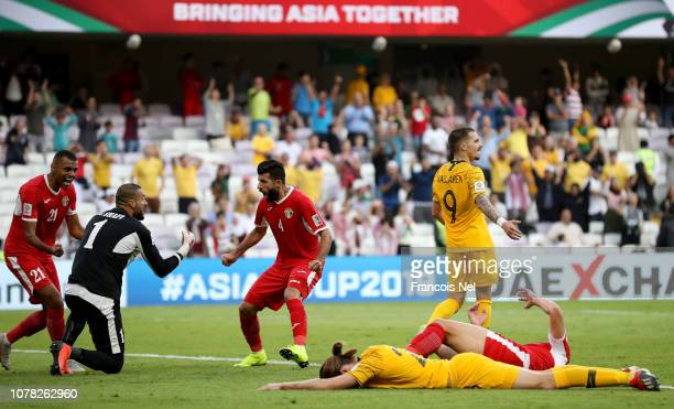 Amer Shafi of Jordan celebrates with his teammates after winning the AFC Asian Cup Group B match between Australia and Jordan at Hazza Bin Zayed...