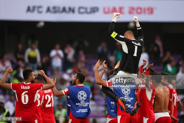 Amer Shafi of Jordan celebrates with his teammates at the end of the AFC Asian Cup Group B match between Australia and Jordan at Hazza Bin Zayed...