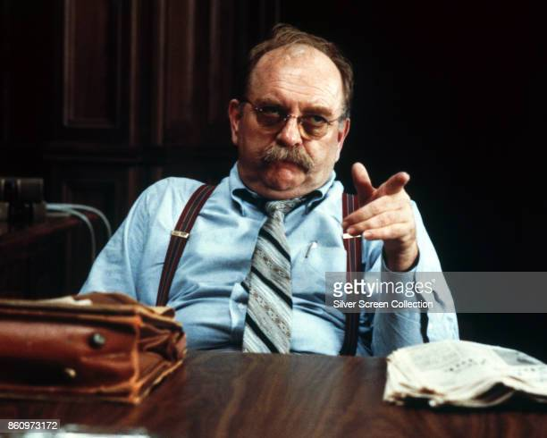 America actor Wilford Brimley points as he sits behind a desk in a scene from 'Absence of Malice' 1981