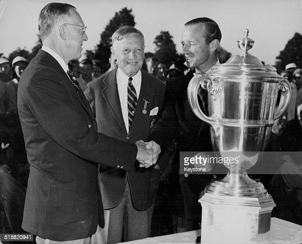 America beat Britain in the Walker Cup Golf Competition: US Team captain Francis Ouimet, USGA President Fielding Wallace and British caption Laddie...