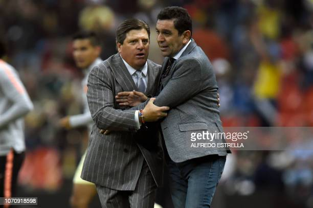 America coach Miguel Herrera says goodbye to Pumas coach David Patino during the second round of semifinals of the Mexican Apertura tournament...