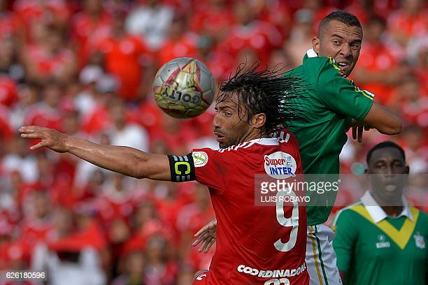 TOPSHOT America de Cali's Ernesto Farias vies for the ball with Deportes Quindio's Jeider Riquett during a Colombian Professional Football tournament...