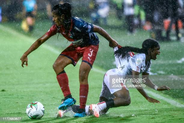 America de Cali's Linda Caicedo vies for the ball with Independiente Medellin's Daniela Arias during the Colombian women's football league final...
