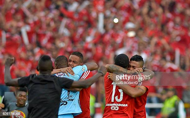 America de Cali's team players celebrate after defeating Deportes Quindio in a Colombian Professional Football tournament promotion match in Cali...