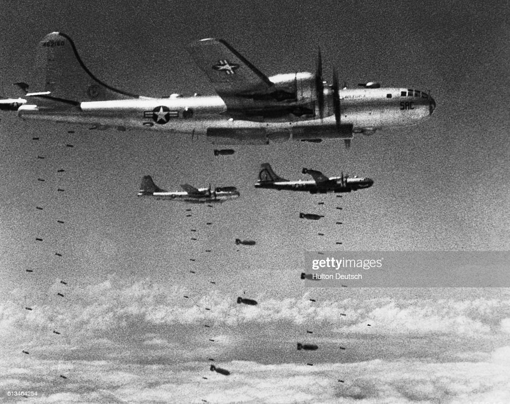America Defends Her Freedom - An Armed Forces Day Historical Feature. US Air Force Superfortresses drop their bomb loads on a strategic target during the Korean conflict. These B-29's also played a major role in the final victory against the Japanese in WWII.