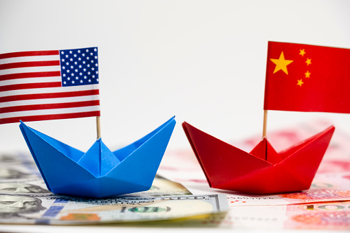 US America flag on blue ship and China flag on red ship and multi color flag with white background of war trade 1043644806