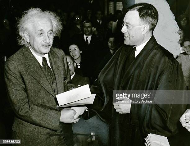America gains a famous citizen October 1 1940 Photograph by Al Au Muller shows Albert Einstein receiving from judge Phillip Foreman his certificate...