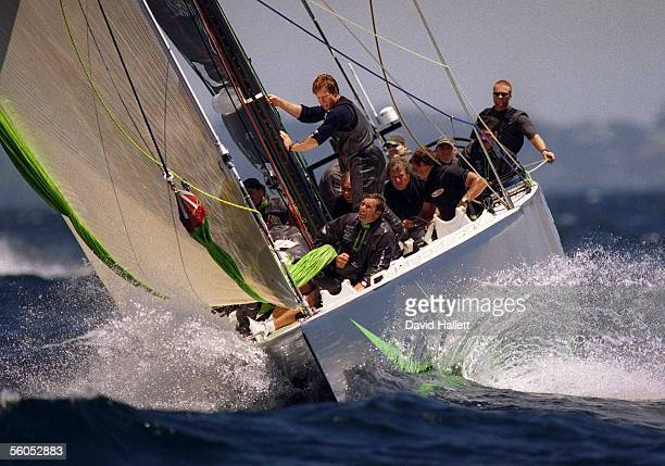 America One prepares to hoist the spinnakar during racing against Stars and Stripes in Round Robin Two racing of the Louis Vuitton Cup Stars and...