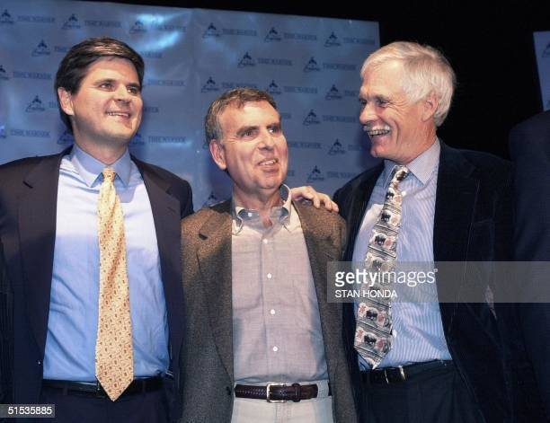 America Online Chairman Steve Case , Time Warner Chairman Gerald Levin and Vice Chairman of Time Warner Ted Turner pose for a photo after they...