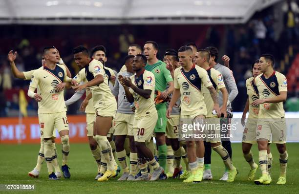 America players celebrate their victory over Pumas during the second round of semifinals of the Mexican Apertura tournament football match at the...