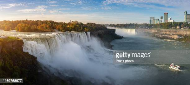america side of niagara falls during sunrise with tourist people on lookout in new york, usa. - ナイアガラ滝 ストックフォトと画像