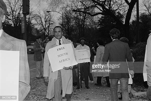 America singer actor and social activist Harry Belafonte attends an antiApartheid demonstration in front of the South African embassy in Washington