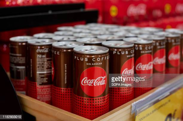 America softdrink cocacola with coffee flavoured cocacola plus coffee displayed for sale at the Carrefour supermarket in Spain