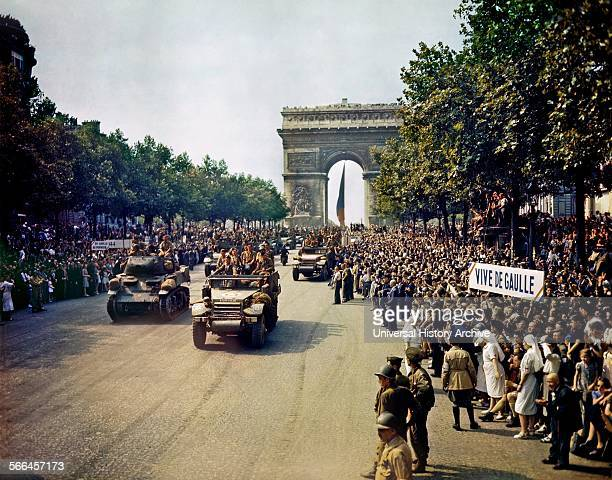 American 2nd Armored Division troops and vehicles parading through the Arc de Triomphe in Paris to celebrate the Liberation of France 1944