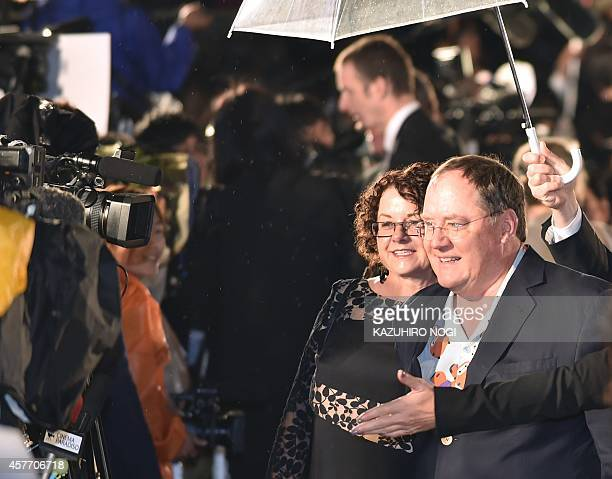 """American 3D computer-animated film """"Big Hero 6"""" executive producer John Lasseter walks on the red carpet for the 27th Tokyo International Film..."""
