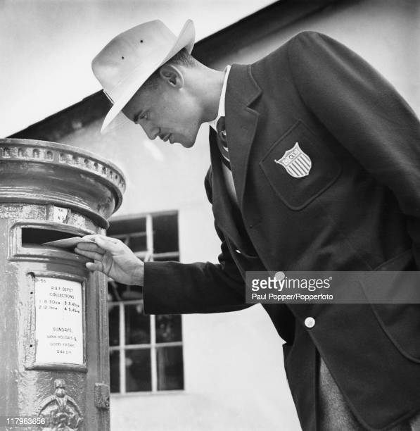 American 800 Metres runner Mal Whitfield posting a letter home from the Olympic training centre at Uxbridge Middlesex during the London Olympics...
