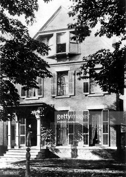 American abolitionist and suffragette Susan B Anthony standing outside her home on 17 Madison Street in Rochester NY late nineteenth century
