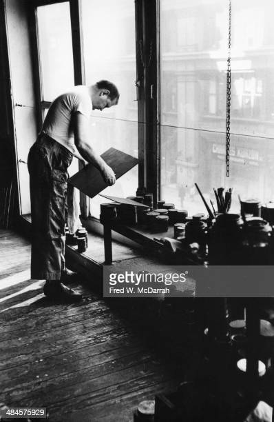 American Abstract artist Ad Reinhardt at work in his studio New York New York March 1 1961