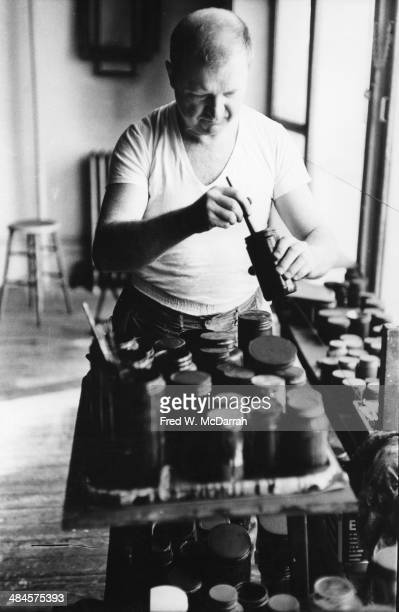 American Abstract artist Ad Reinhardt mixes paint in his studio New York New York March 1 1961