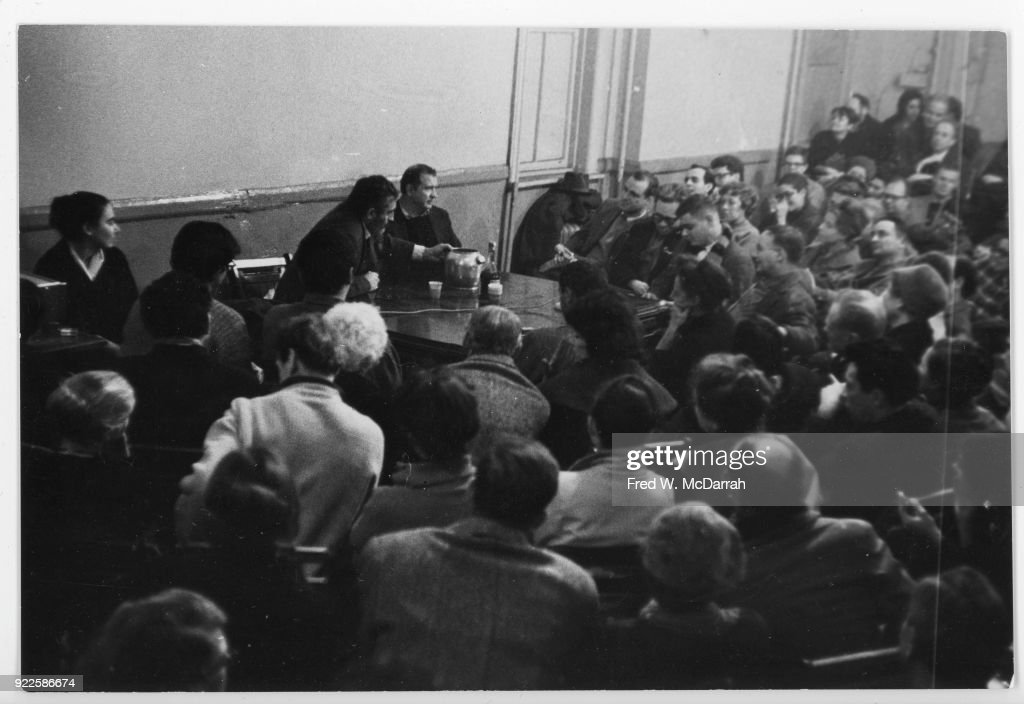 American Abstract Expressionist artist Ad Reinhardt (1913 - 1967) (center) moderates a panel discussion (about artist Milton Resnick) at the Artist's Club, New York, New York, January 1, 1961.