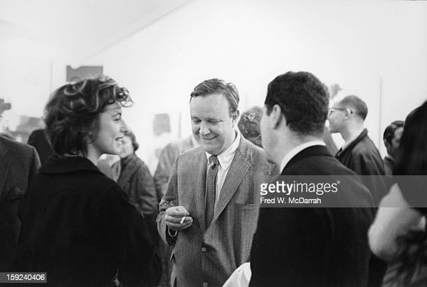 American abstract expressionists painters Helen Frankenthaler and Robert Motherwell speak with an unidentified third person at the Jackson Gallery...
