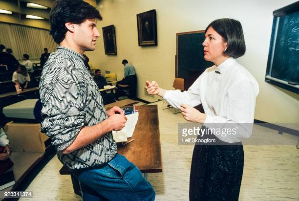 American academic Professor Elizabeth Warren speaks with an unidentified student in a leture hall after class at University of Pennsylvania Law...