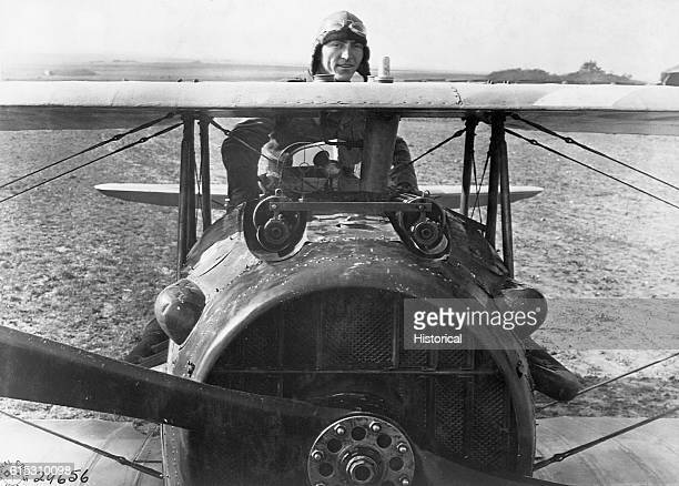 American ace of the 94th Aero Squadron First Lieut Edward [Eddie] V Rickenbacker stands up in his Spad plane near Rembercourt France during World War...