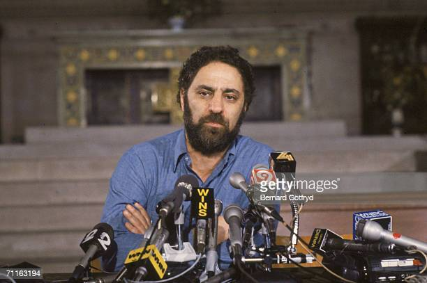 American activisit Abbie Hoffman stands before several microphones as he holds a press conference early 1980s