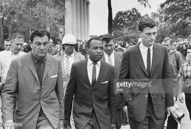 American activist James Meredith on his way to class at University of Mississippi, escorted by US Marshal James McShane, left, and John Doar of the...