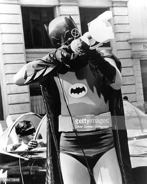 American actor Adam West as Batman in the US TV series 'Batman' circa 1967 In the background is Burt Ward as Robin