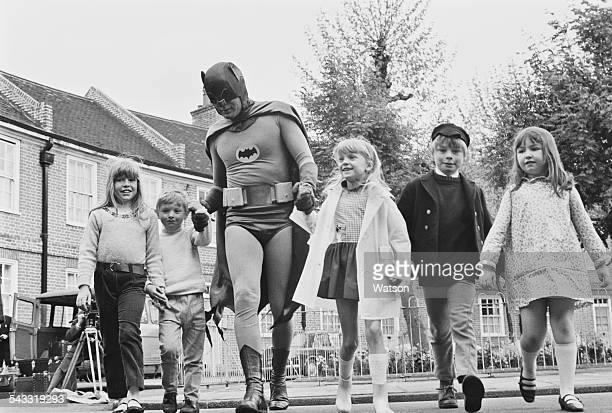 American actor Adam West dressed as 'Batman' for the filming of a road safety advert for children, 7th May 1967.