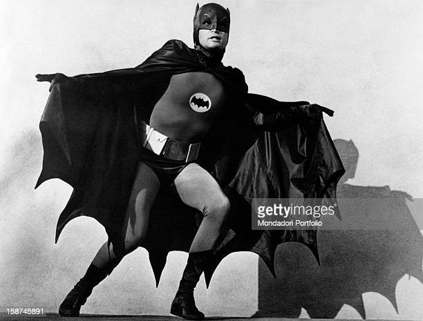 American actor Adam West wearing the costume of the comics superhero Batman and acting in the TV serie Batman 1966
