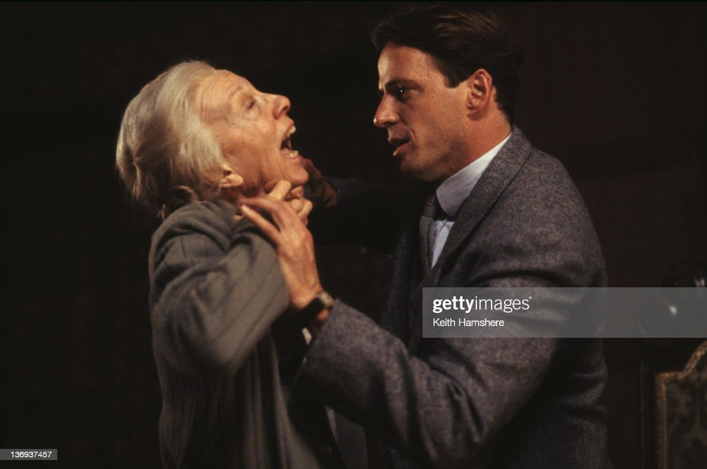 American actor Aidan Quinn throttles English actress Anna Massey (1937 - 2011) in a scene from the film 'Haunted', 1995.