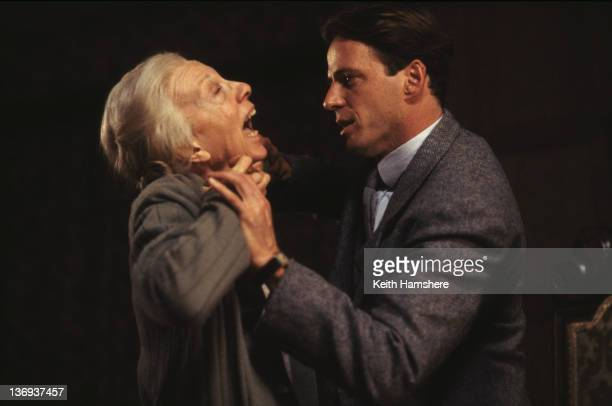 American actor Aidan Quinn throttles English actress Anna Massey in a scene from the film 'Haunted' 1995