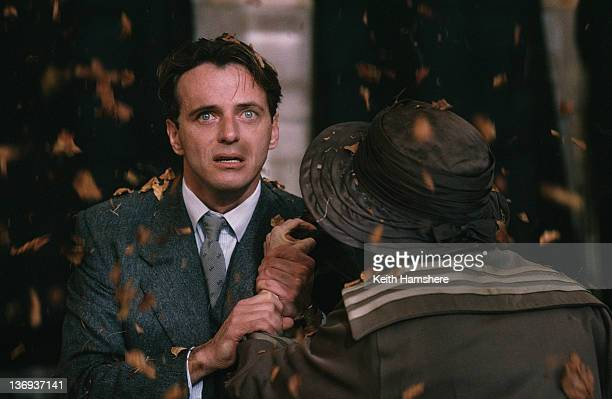 American actor Aidan Quinn with English actress Anna Massey in a scene from the film 'Haunted' 1995