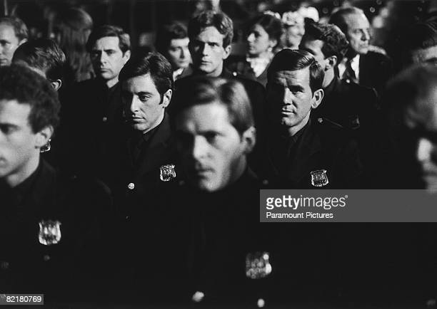 American actor Al Pacino as officer Frank Serpico attends his police academy graduation ceremony in a scene from Sidney Lumet's police corruption...