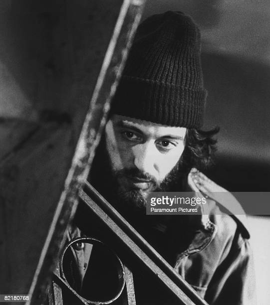 American actor Al Pacino as officer Frank Serpico waits in a hallway before apprehending drug dealers in a scene from Sidney Lumet's police...