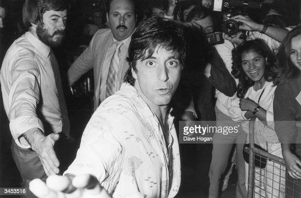 American actor Al Pacino makes his way to his car, surrounded by fans and photographers, 1984.