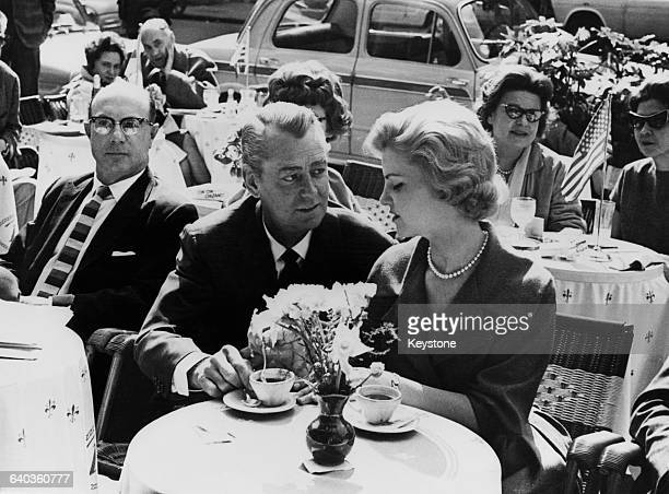 American actor Alan Ladd and his daughter Alana drinking coffee in a cafe on the Via Veneto, Rome, 22nd March 1961. They are both in Italy to star in...