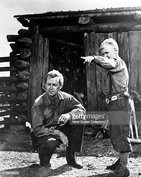 American actor Alan Ladd as Shane, and Brandon De Wilde as Joey Starrett, in 'Shane', directed by George Stevens, 1953.